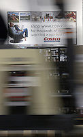 A fork truck rolls through the aisles preparing for the doors to open at a Costco Wholesale Warehouse Friday, March 9, 2007 in Columbus, Ohio.