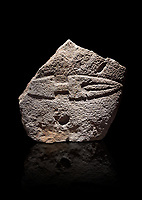 Fragmant of a Late European Neolithic prehistoric Menhir standing stone with carving of a knife on its face side.  Excavated from Palas de Nuraxi II, Laconi. Menhir Museum, Museo della Statuaria Prehistorica in Sardegna, Museum of Prehoistoric Sardinian Statues, Palazzo Aymerich, Laconi, Sardinia, Italy. Black background.
