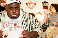 """""""Badlands"""" Booker, flanked by a """"supportive Jewish mother"""", at the World Matzah Ball Eating Championship in New York City on April 20, 2005."""