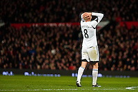 Saturday 11 January 2014 Pictured: Jonjo Shelvey with his head in his hands after missing a shot<br /> Re: Barclays Premier League Manchester Utd v Swansea City FC  at Old Trafford, Manchester