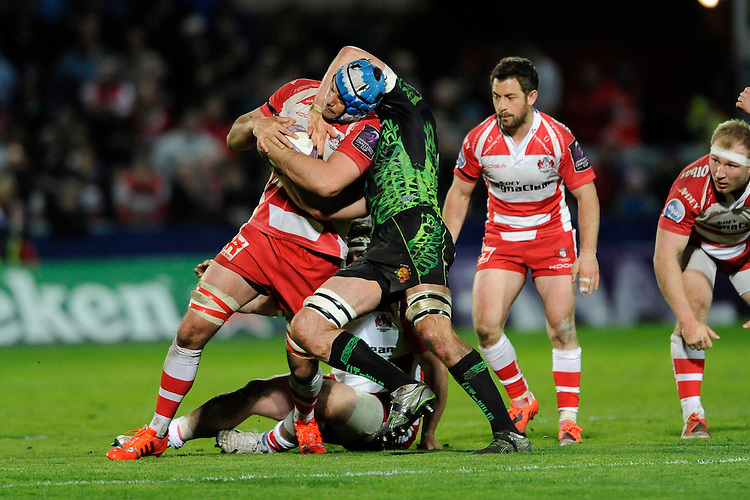 Mariano Galarza of Gloucester Rugby is tackled around the neck by Dean Mumm of Exeter Chiefs during the European Rugby Challenge Cup semi final match between Gloucester Rugby and Exeter Chiefs at Kingsholm Stadium on Saturday 18th April 2015 (Photo by Rob Munro)