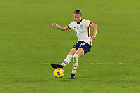 ORLANDO, FL - JANUARY 22: Emily Sonnett #14 passes the ball during a game between Colombia and USWNT at Exploria stadium on January 22, 2021 in Orlando, Florida.