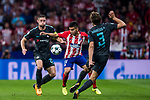 Angel Correa (c) of Atletico de Madrid competes for the ball with Gary Cahill (l) and Marcos Alonso of Chelsea FC during the UEFA Champions League 2017-18 match between Atletico de Madrid and Chelsea FC at the Wanda Metropolitano on 27 September 2017, in Madrid, Spain. Photo by Diego Gonzalez / Power Sport Images