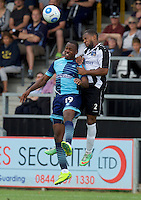 Myles Weston of Wycombe Wanderers  wins the header from Ryan Peters of Maidenhead United during the Friendly match between Maidenhead United and Wycombe Wanderers at York Road, Maidenhead, England on 30 July 2016. Photo by Alan  Stanford PRiME Media Images.