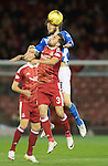 Aberdeen v St Johnstone…22.09.16.. Pittodrie..  Betfred Cup<br />Murray Davidson outjumps Graeme Shinnie<br />Picture by Graeme Hart.<br />Copyright Perthshire Picture Agency<br />Tel: 01738 623350  Mobile: 07990 594431