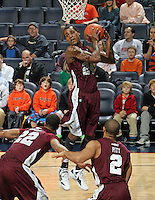 CHARLOTTESVILLE, VA- December 27: Hillary Haley #24 of the Maryland-Eastern Shore Hawks grabs a rebound under Ron Spencer (22) and Ishaq Pitt (2) during the game against the Virginia Cavaliers on December 27, 2011 at the John Paul Jones Arena in Charlottesville, Va. Virginia defeated Maryland Eastern Shore 69-42.  (Photo by Andrew Shurtleff/Getty Images) *** Local Caption *** Ishaq Pitt;Ron Spencer;Hillary Haley