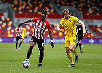 14th February 2021; Brentford Community Stadium, London, England; English Football League Championship Football, Brentford FC versus Barnsley; Ivan Toney of Brentford is covered by Michal Helik of Barnsley