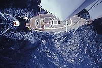 Sailing Yacht 'Heron', a Halberg-Rassy 46, under full sail, seen from masthead off the coast of Niihau Island, Hawaii