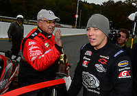 Oct. 8, 2012; Mohnton, PA, USA: NHRA runner-up driver Dave Connolly congratulates pro stock driver V. Gaines as he celebrates after winning the Auto Plus Nationals at Maple Grove Raceway. Mandatory Credit: Mark J. Rebilas-