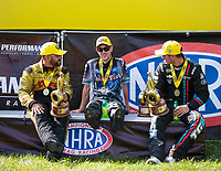 Sep 3, 2018; Clermont, IN, USA; NHRA funny car driver J.R. Todd (left), pro stock motorcycle rider L.E. Tonglet (center) and pro stock driver Tanner Gray after winning the US Nationals at Lucas Oil Raceway. Mandatory Credit: Mark J. Rebilas-USA TODAY Sports