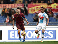 Roma's Diego Perotti, left, is chased by Napoli's Faouzi Ghoulam in action during the Italian Serie A football match between Roma and Napoli at Rome's Olympic stadium, 4 March 2017. <br /> UPDATE IMAGES PRESS/Isabella Bonotto