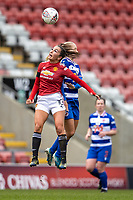 7th February 2021; Leigh Sports Village, Lancashire, England; Women's English Super League, Manchester United Women versus Reading Women; Katie Zelem of Manchester United Women and Amalie Eikeland of Reading jump to head the ball