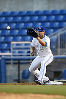 Dunedin Blue Jays first baseman Matt Dean (33) stretches for a throw during a game against the Clearwater Threshers on April 10, 2015 at Florida Auto Exchange Stadium in Dunedin, Florida.  Clearwater defeated Dunedin 2-0.  (Mike Janes/Four Seam Images)