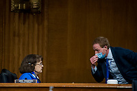 """United States Senator Dianne Feinstein (Democrat of California), Ranking Member, US Senate Judiciary Committee confers with a staff member while Professor Russell A. Miller, J.B. Stombock Professor of Law Washington and Lee University School of Law Lexington, VA, and Professor Chimene Keitner, Alfred And Hanna Fromm Professor Of International Law UC Hastings Law San Francisco San Francisco, CA, testify during a US Senate Committee on the Judiciary hearing entitled """"The Foreign Sovereign Immunities Act, Coronavirus, and Addressing Chinaís Culpability"""" in the Dirksen Senate Office Building on Capitol Hill in Washington, DC., Tuesday, June 23, 2020. Credit: Rod Lamkey / CNP<br /> Credit: Rod Lamkey / CNP/AdMedia"""