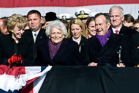 From right, President George H. W. Bush, former First Lady Barbara Bush and Lynn Cheney, the wife of Vice President Dick Cheney, share a laugh during the commissioning ceremony of the Nimitz-class nuclear powered aircraft carrier USS George H. W. Bush (CVN 77) at Naval Station Norfolk, Va., Jan. 10, 2009. Bush, the ship?s namesake, attended the ceremony along with several other members of the Bush family, including President George W. Bush and First Lady Laura Bush. (DoD photo by Cherie Cullen/Released)