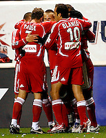 Chicago Fire forward Chris Rolfe (17) is mobbed by his teammates after scoring the game's only goal. The Chicago Fire defeated D. C. United 1-0 during the first leg of the MLS Eastern Conference Semifinal Series at Toyota Park in Bridgeview, IL, on October 25, 2007.