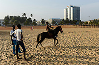 TOGO, Lome, abandoned Hotel Palm Beach, beach and sea shore atlantic ocean, beach horse riding /  Strand am Atlantik, Strandpferde