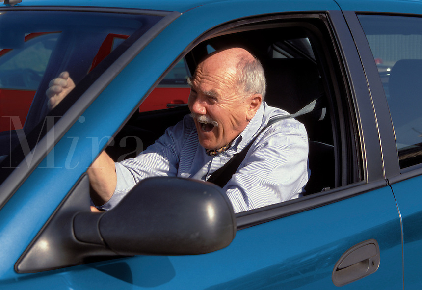 Road rage.  Angry motorist gesturing at other motorists.