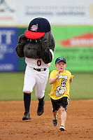 Brevard County Manatees  mascot lags behind a young fan in the base race during a game against the Clearwater Threshers at Space Coast Stadium on April 29, 2012 in Viera, Florida.  Brevard County defeated Clearwater 4-1.  (Mike Janes/Four Seam Images)