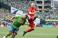 SEATTLE, WA - NOVEMBER 10: Roman Torres #29 of the Seattle Sounders FC and Michael Bradley #4 of Toronto FC challenge for a ball in the penalty area during a game between Toronto FC and Seattle Sounders FC at CenturyLink Field on November 10, 2019 in Seattle, Washington.