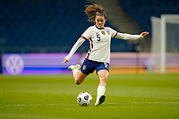 LE HAVRE, FRANCE - APRIL 13: Kelley O'Hara #5 of the United States sends a ball downfield during a game between France and USWNT at Stade Oceane on April 13, 2021 in Le Havre, France.