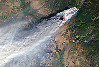 Landsat 8 satellite view of the Camp Fire, Paradise, Butte County, California, November 8, 2018, one of the world's deadliest wildfires.  This image is in the public domain, a high resolution digital file can be obtained at from this web site or at: https://eoimages.gsfc.nasa.gov/images/imagerecords/144000/144225/campfire_oli_2018312_crop_lrg.jpg.  Prints of this satellite image can be ordered from this web site.