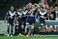 MELBOURNE, AUSTRALIA - DECEMBER 11: Victory players celebrate Adrian Leijer's goal during the round 18 A-League match between the Melbourne Heart and Melbourne Victory at AAMI Park on December 11, 2010 in Melbourne, Australia. (Photo by Sydney Low / Asterisk Images)