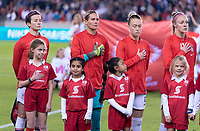 HOUSTON, TX - JANUARY 31: Megan Rapinoe #15, Ashlyn Harris #12, Emily Sonnett #2 and Becky Sauerbrunn #4 of the United States stand during the national anthem during a game between Panama and USWNT at BBVA Stadium on January 31, 2020 in Houston, Texas.