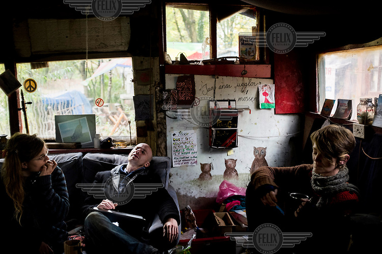 People in a communal room at the Faslane Peace Camp, where anti-nuclear protesters have been camped, next to the Faslane base, for 32 years.