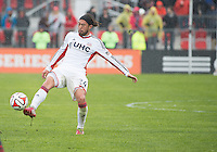 Toronto, Ontario - May 3, 2014: New England Revolution midfielder/forward Lee Nguyen #24 in action during a game between the New England Revolution and Toronto FC at BMO Field.<br /> The New England Revolution won 2-1.