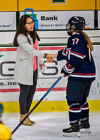 8 February 2020: University of Vermont Catamount Associate Head Coach Jess Koizumi, entering her 3rd season of coaching at Vermont, shakes hands with University of Connecticut Husky Amy Landry after a game at Gutterson Fieldhouse in Burlington, Vermont. The Huskies defeated the Lady Cats 4-2 in the first game of their weekend Hockey East series. Mandatory Credit: Ed Wolfstein Photo *** RAW (NEF) Image File Available ***