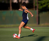 KASHIMA, JAPAN - AUGUST 1: Carli Lloyd #10 of the USWNT strikes the ball during a training session at the practice field on August 1, 2021 in Kashima, Japan.