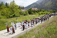 Switzerland. Canton Valais. St-Maurice. Africa Saints Pilgrimage (Pèlerinage aux Saints d'Afrique). Religious <br /> procession. The people, dressed in white, are originally from Eritrea. They walk in front of the procession and carry the cross. The procession goes from Véroliez  a quarter of St-Maurice to St-Maurice's abbey.  2.06.13 © 2013 Didier Ruef
