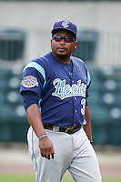 Corpus Christi Hooks manager Rodney Linares (33) walks to the dugout after the lineup exchange before a game against the Arkansas Travelers on May 29, 2015 at Dickey-Stephens Park in Little Rock, Arkansas.  Corpus Christi defeated Arkansas 4-0 in a rain shortened game.  (Mike Janes/Four Seam Images)
