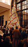 Visitors gather around the Christmas tree at the opening night of The Nutcracker at the Wortham Theater Friday Nov. 27,2009. (Dave Rossman/For the Chronicle)