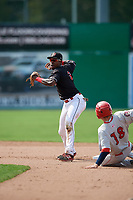 Batavia Muckdogs shortstop Demetrius Sims (3) throws to first base to try to complete a double play as Jacob Rhinesmith (18) slides into second base during a game against the Auburn Doubledays on September 1, 2018 at Dwyer Stadium in Batavia, New York.  Auburn defeated Batavia 10-5.  (Mike Janes/Four Seam Images)