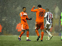 Pictured L-R: Teaam mates Scott Sinclair and Danny Graham of Swansea congratulate each other after the final whistle. Saturday, 04 February 2012<br /> Re: Premier League football, West Bromwich Albion v Swansea City FC v at the Hawthorns Stadium, Birmingham, West Midlands.