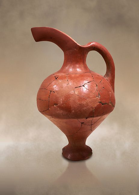 Hittite terra cotta red glazed beak spout pitcher . Hittite Period, 1600 - 1200 BC.  Hattusa Boğazkale. Çorum Archaeological Museum, Corum, Turkey. Against a warm art bacground.