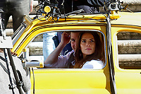 Actor Tom Cruise and actress Hayley Atwell in a Fiat yellow 500 driven by a stuntman, during a an action scene on the set of the film Mission Impossible 7 at Spagna square, just under the Spanish steps.<br /> Rome (Italy), November 22nd 2020<br /> Photo Samantha Zucchi Insidefoto
