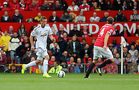 Pictured L-R: Gylfi Sigurdsson of Swansea against Phil Jones of Manchester United. Saturday 16 August 2014<br />
