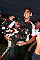 Sep 2, 2017; Clermont, IN, USA; NHRA top fuel driver Steve Torrence celebrates with crew after winning the Traxxas Shootout specialty race during qualifying for the US Nationals at Lucas Oil Raceway. Mandatory Credit: Mark J. Rebilas-USA TODAY Sports
