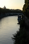 View over the River Tiber to the dome of St Peter's in Rome.