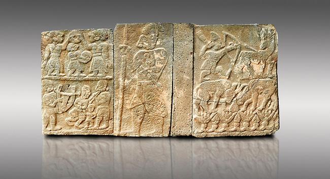 Pictures & images of the North Gate Hittite sculpture stele depicting Hittite Gods. 8th century BC. Karatepe Aslantas Open-Air Museum (Karatepe-Aslantaş Açık Hava Müzesi), Osmaniye Province, Turkey. Against grey background