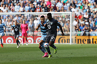 ST. PAUL, MN - AUGUST 21: Patrick Weah #29 of Minnesota United FC and Daniel Salloi #20 of Sporting Kansas City battle for the ball during a game between Sporting Kansas City and Minnesota United FC at Allianz Field on August 21, 2021 in St. Paul, Minnesota.