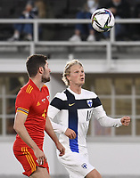 September 1st 2021: Helsinki, Finland;  Ben Davies of Wales L and Finlands Urho Nissilu during the International Friendly, Finland versus Wales at the Helsinki Olympic Stadium