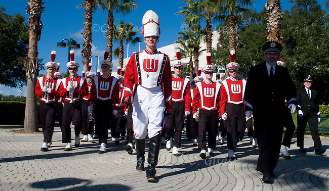 Drum Major Adam Gill leads the University of Wisconsin Marching Band towards the staging area for the 2007 Citrus Parade, held on December 30, 2006 in Orlando Fla. The band would go on later in the week to play during the Capital One Bowl held between Wisconsin and the University of Arkansas.