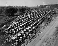 Mighty battalion of Mack war trucks, all for the Engrs.  Corps. Manufactured by the International Motor Co., Allentown, Pa.   Ca.  1918.   G. W. King. (War Dept.)<br />Exact Date Shot Unknown<br />NARA FILE #:  165-WW-309D-6<br />WAR & CONFLICT BOOK #:  574