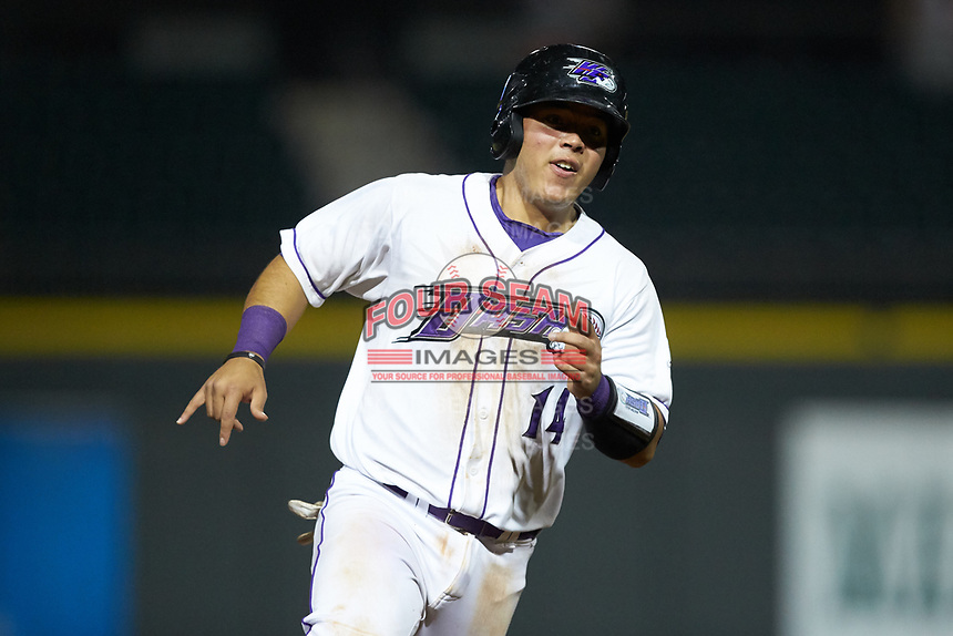 Carlos Perez (14) of the Winston-Salem Dash hustles towards third base against the Lynchburg Hillcats at BB&T Ballpark on May 9, 2019 in Winston-Salem, North Carolina. The Dash defeated the Hillcats 4-1. (Brian Westerholt/Four Seam Images)