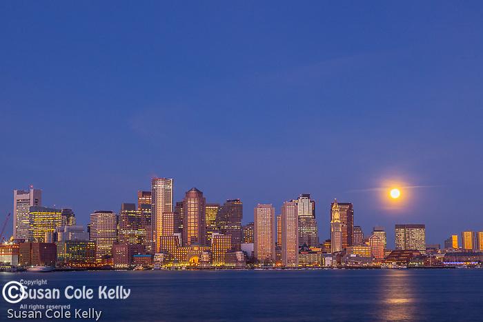 Moonset on the Boston waterfront, Boston, Massachusetts, USA