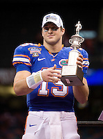 01 January 2010:  Florida's quarterback Tim Tebow holds up MVP trophy after winning the game against Cincinnati during Sugar Bowl at the SuperDome in New Orleans, Louisiana.  Florida defeated Cincinnati, 51-24.